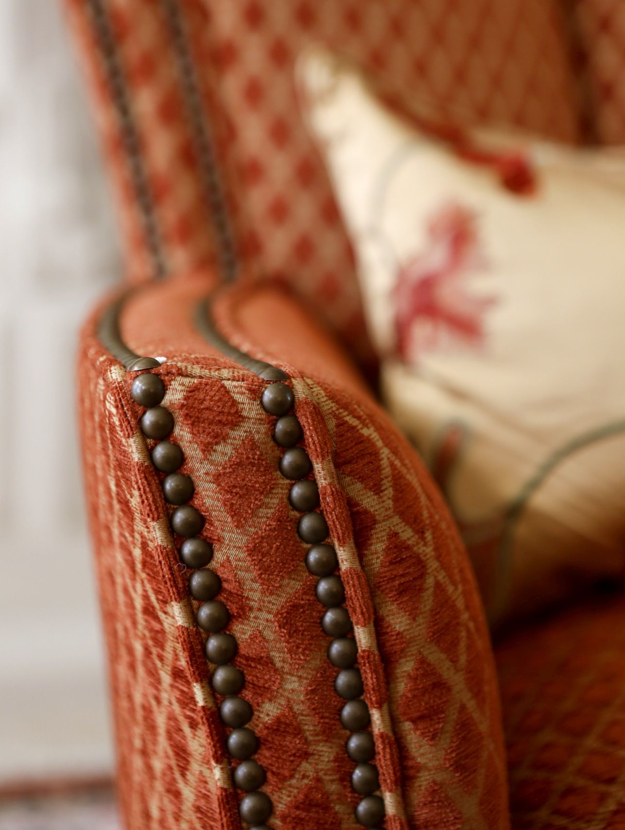 pretty burnt orange upholstery with nailhead detail