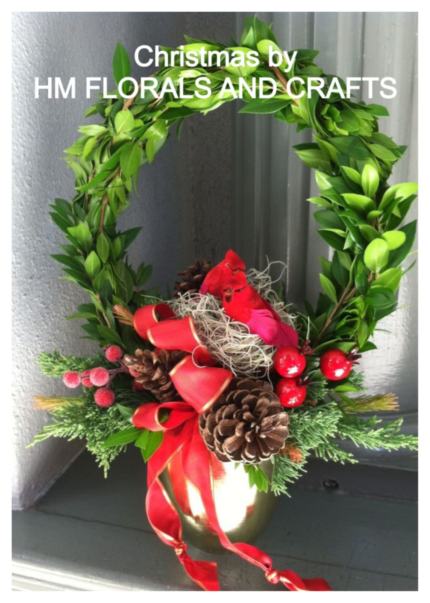 Christmas Wreath with nesting cardinals.