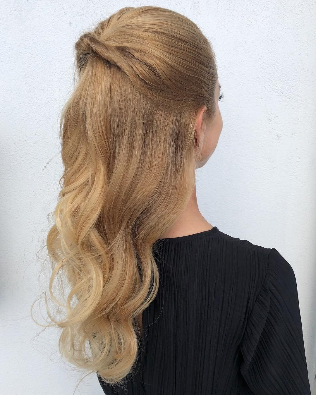 This romantic half up wedding hair style by hair by kiesler features