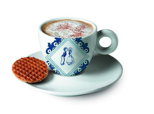 A cup of coffee with a mini stroopwafel
