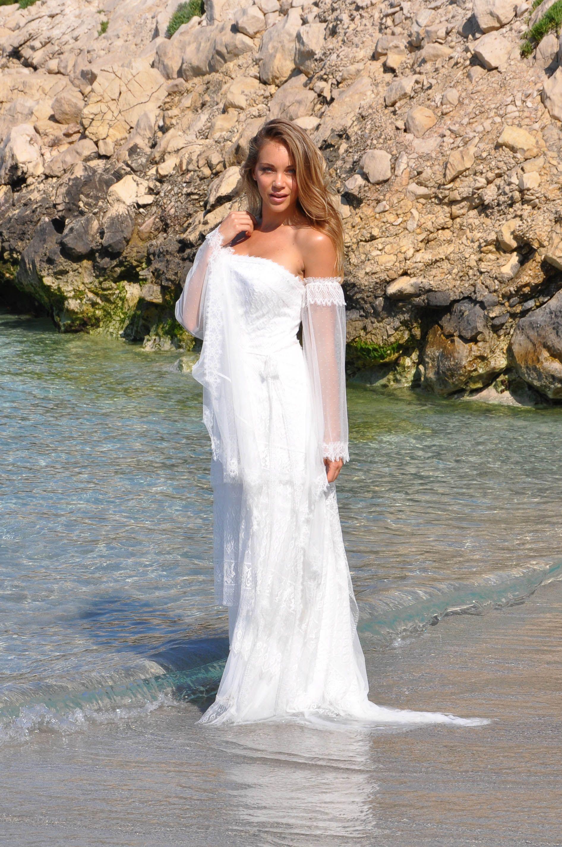 robe de mariée bohème en dentelle manches longues forme