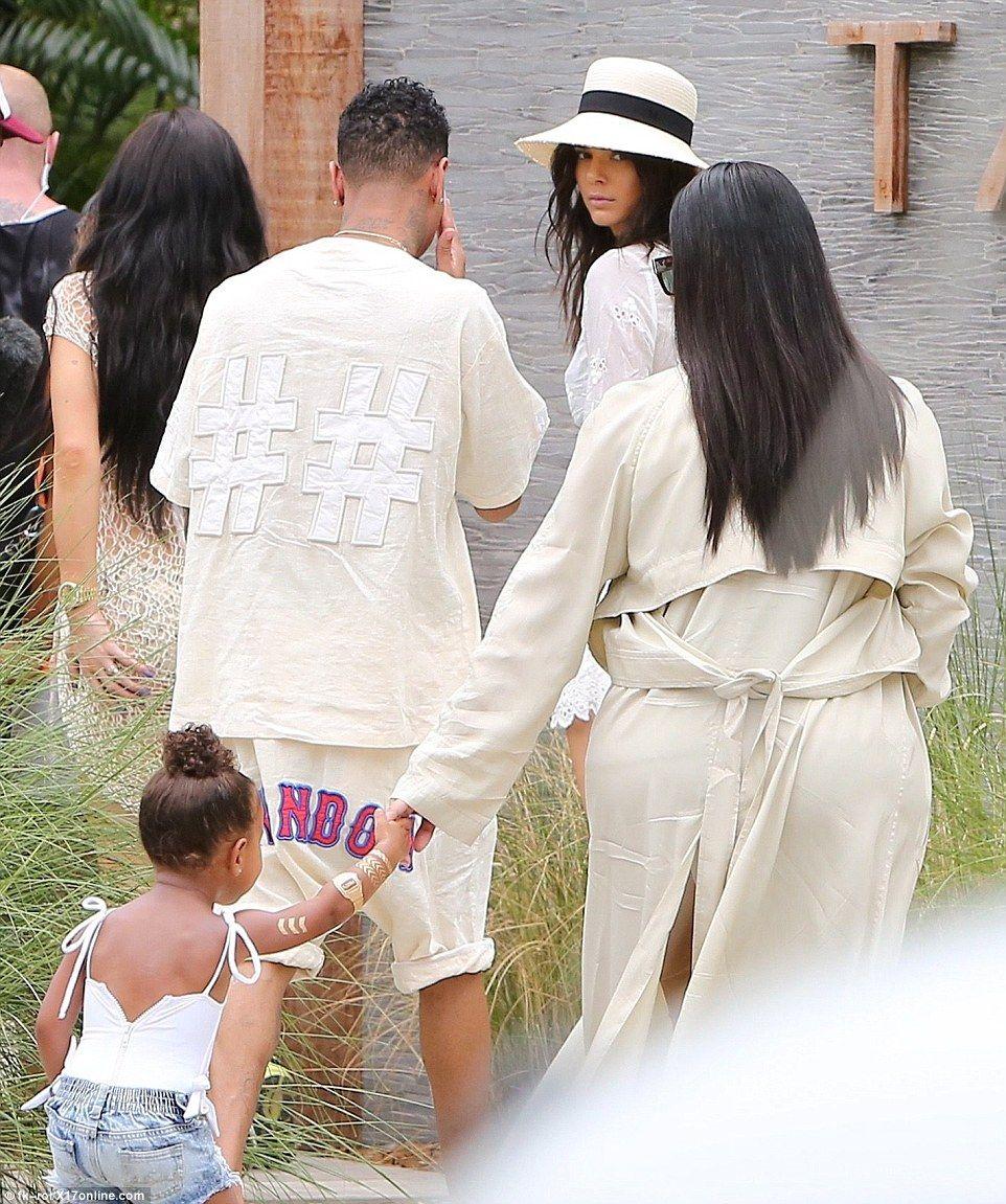Khloe kardashian wedding dress  Kim Kardashian is uboredu as sheus left holding kids in St Barts