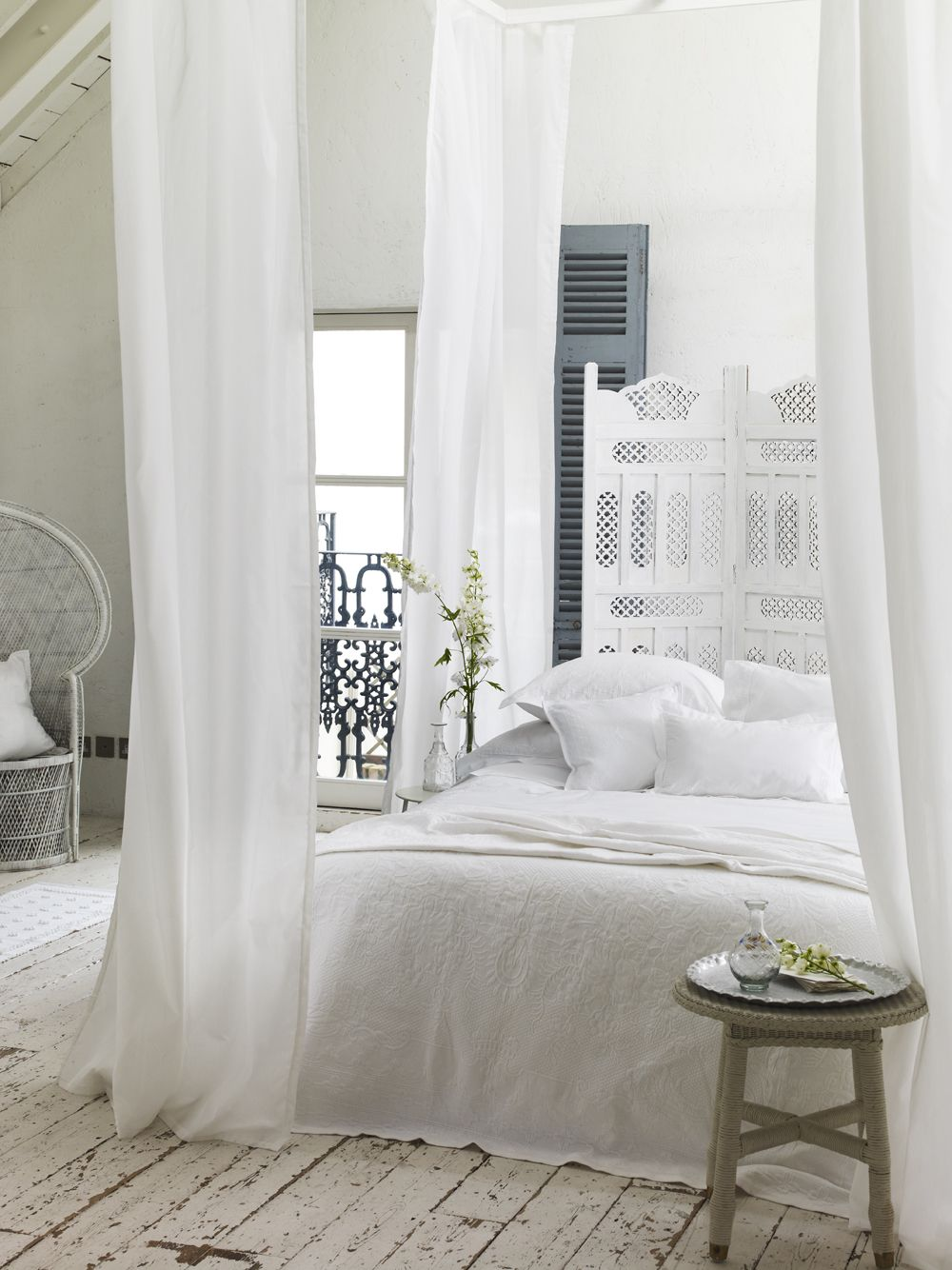 lovely ethereal and romantic white bedroom with quirky and unique