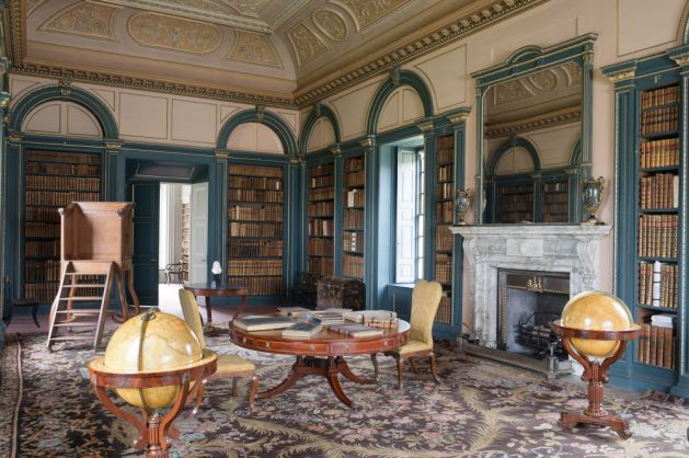 View of the Library looking towards the Book Room. The set of library steps began its life as a pulpit. The pair of globes dates from the early nineteenth century.