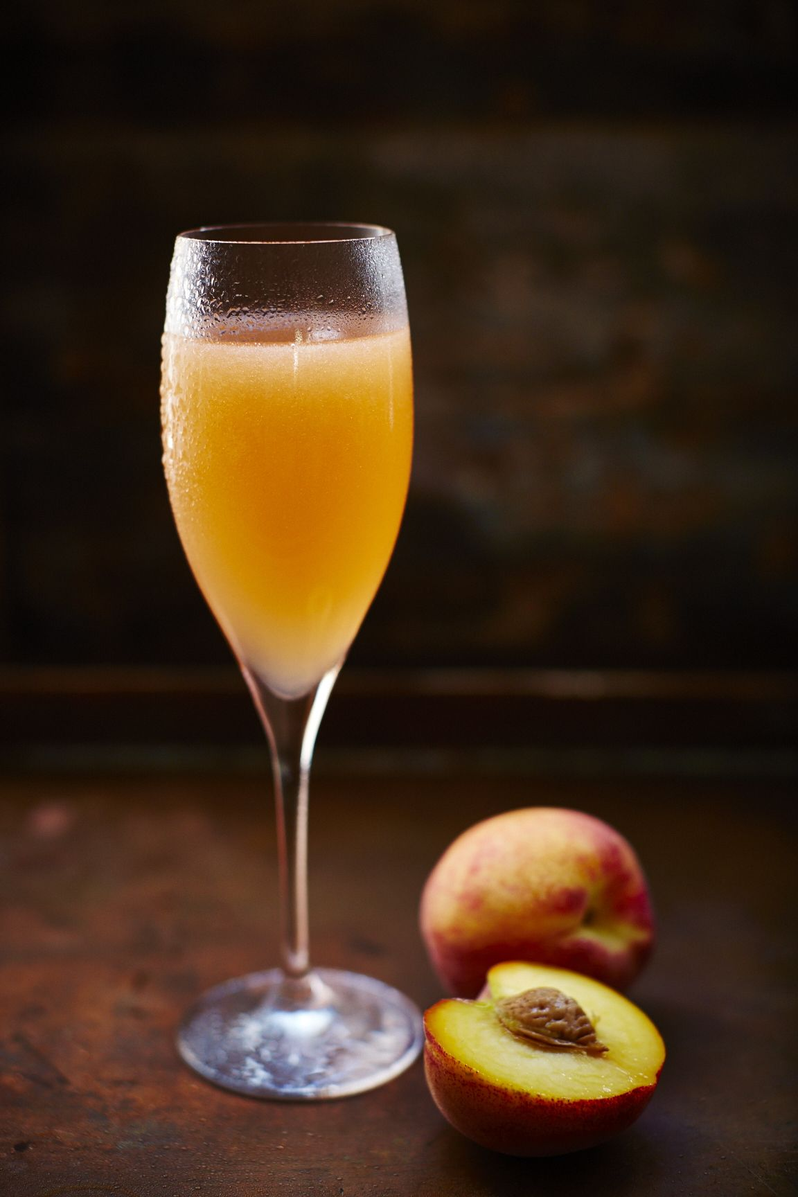 The classic peach Bellini cocktail with peaches and ...