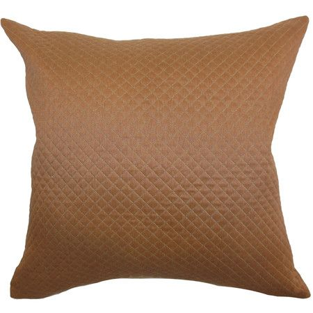 Add a touch of texture to your sofa, arm chair, or bed with this charming pillow, showcasing a quilted design in brown.   Product: P...