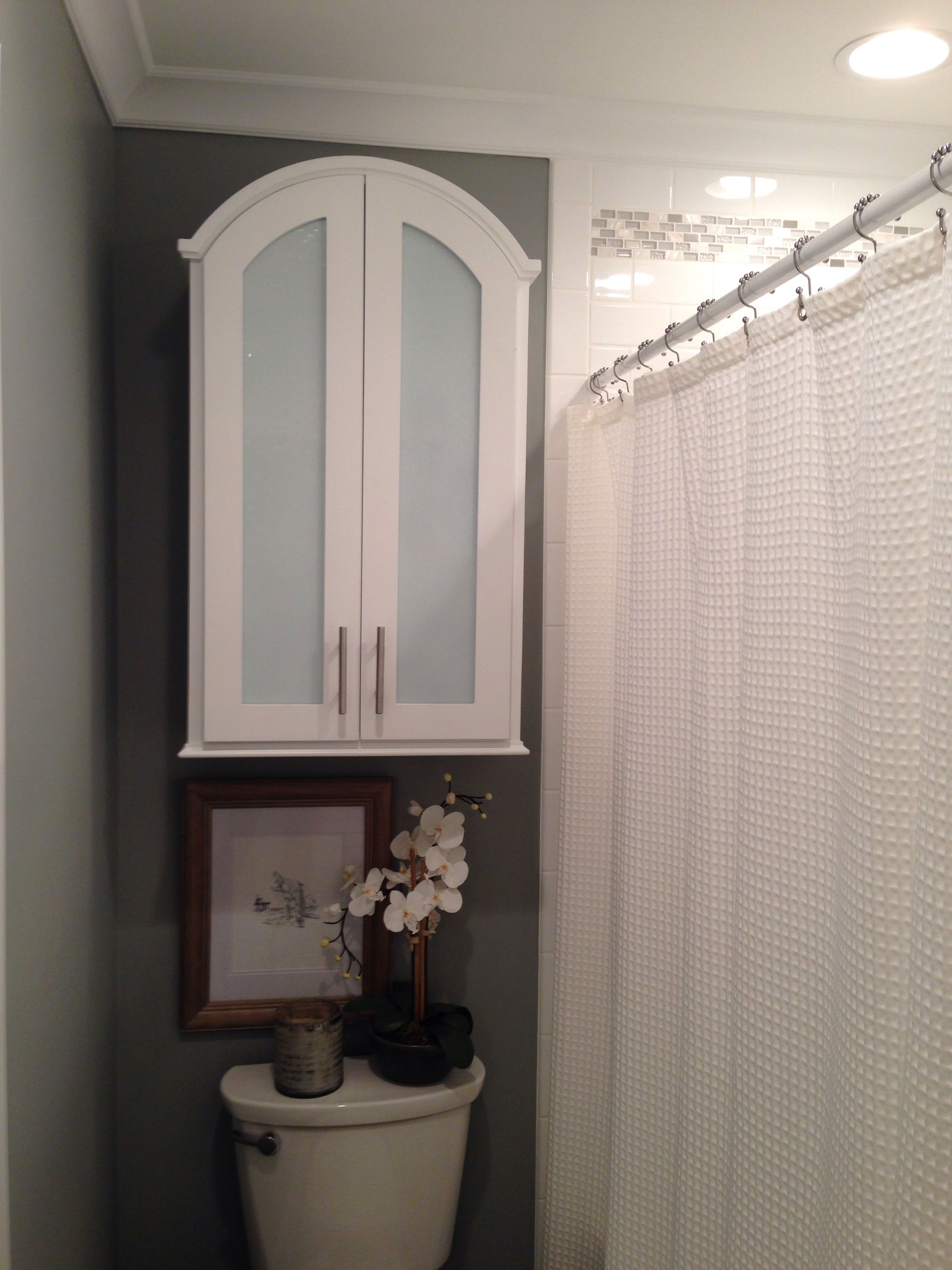 Glass front wall cabinet with radius top plus custom tile surround ...