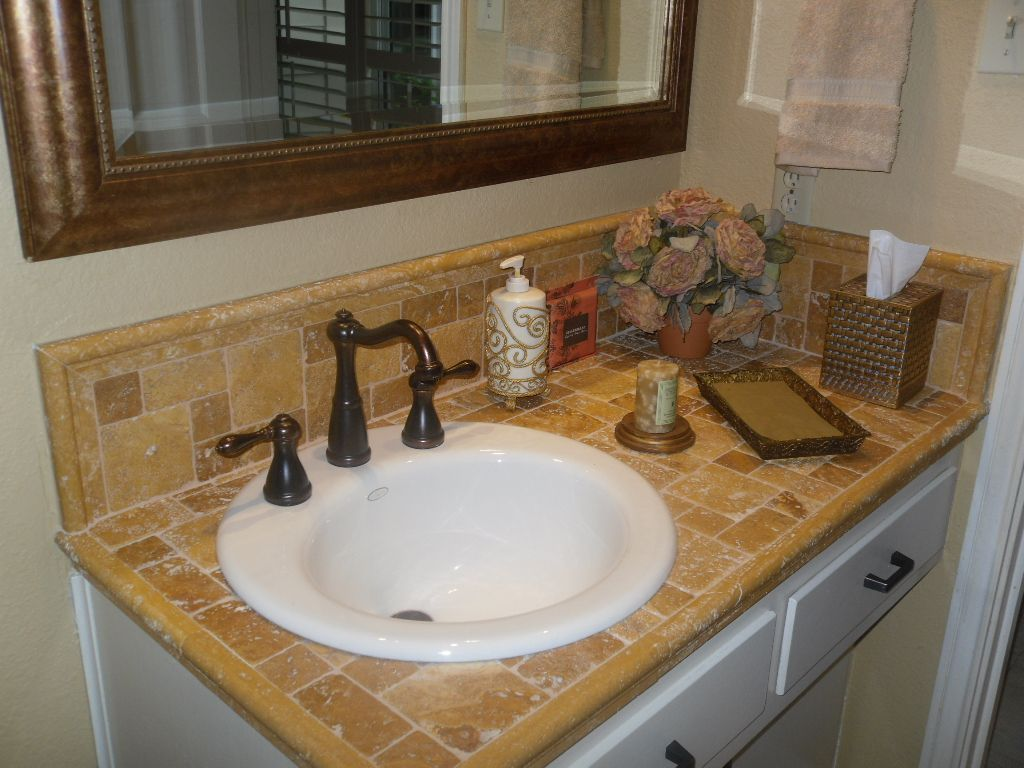 Travertine tile counter top with porcelin sink master for Travertine tile bathroom gallery