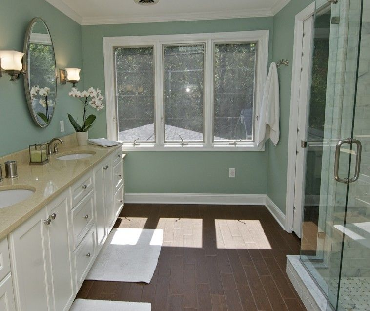 Dark Brown Bathroom Tile Floor Connected By White Wooden Bathroom Vanity  And Green Wall Theme