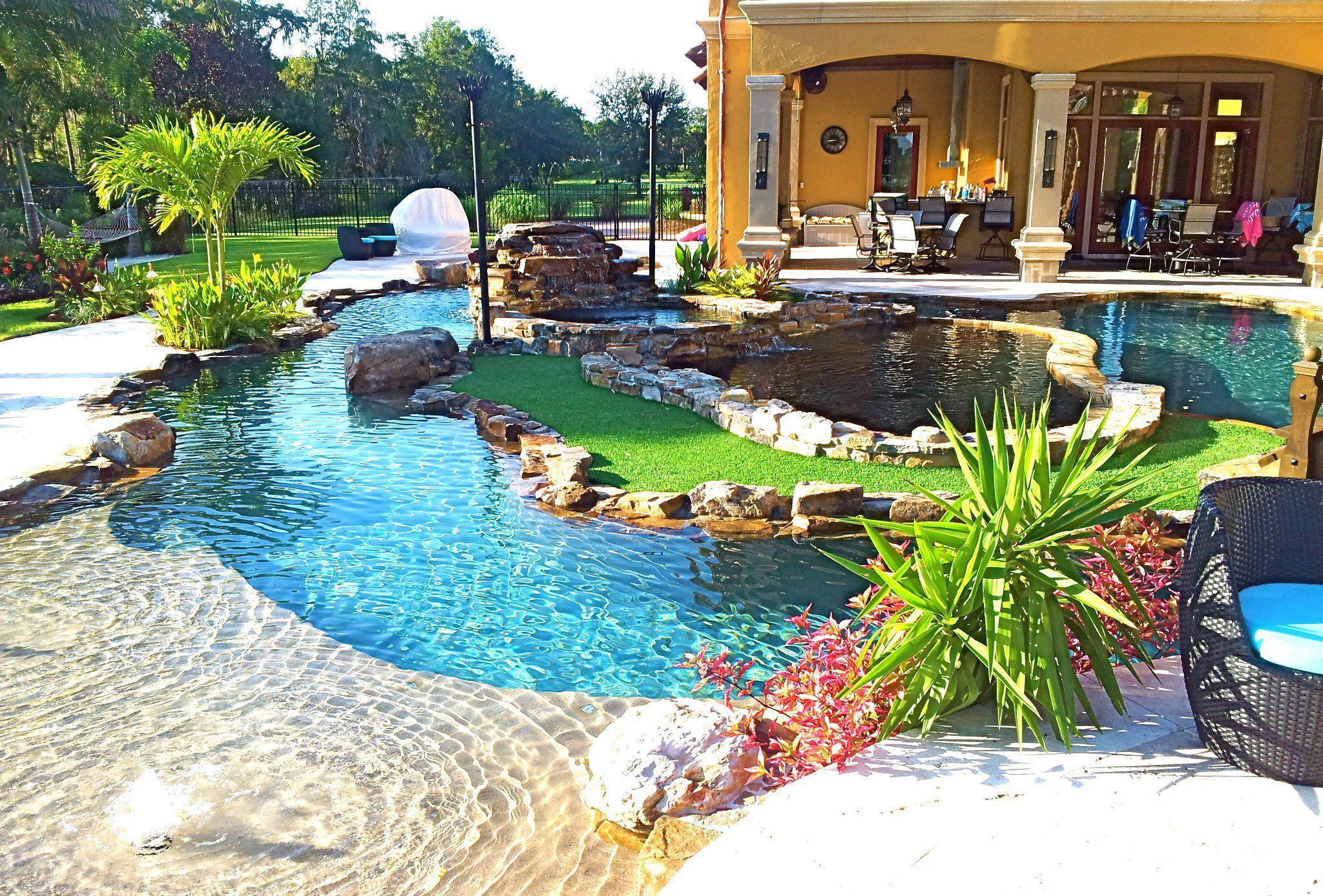 Backyard oasis lazy river pool with island lagoon and for Pictures of backyard pools