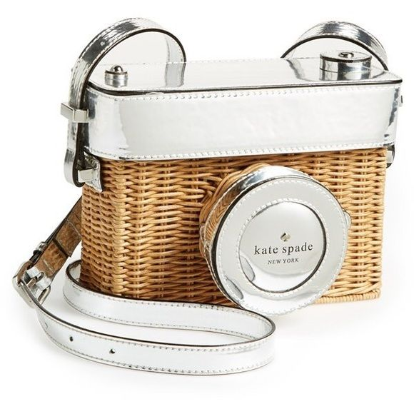 """kate spade """"grand tour"""" wicker camera bag ULTRA RARE AND SOLD OUT! Whether you're touring the Italian countryside or just going to your local farmers' market, you'll always be camera ready in this cute-as-can-be hand-woven wicker shoulder bag with metallic accents. Removable box top. Adjustable strap. Exterior snap compartment. Interior card pocket. Signature stripe lining. *Love this bag but I need the money! Will only sell for a good price. Purchased for over retail but only used once…"""