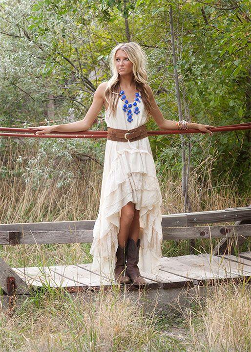 Cream dress, brown belt, brown boots, blue statement necklace ...