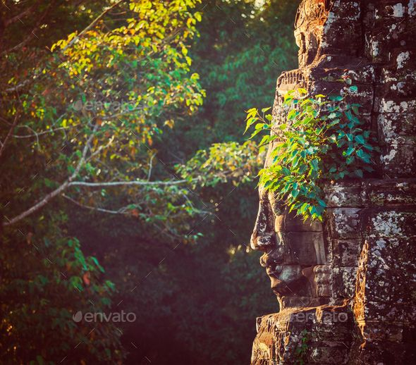Face of Bayon temple, Angkor, Cambodia by f9photos. Vintage retro effect filtered hipster style travel image of ancient stone face of Bayon temple, Angkor, Cambodia with... #AD #f9photos, #Cambodia, #retro, #Vintage