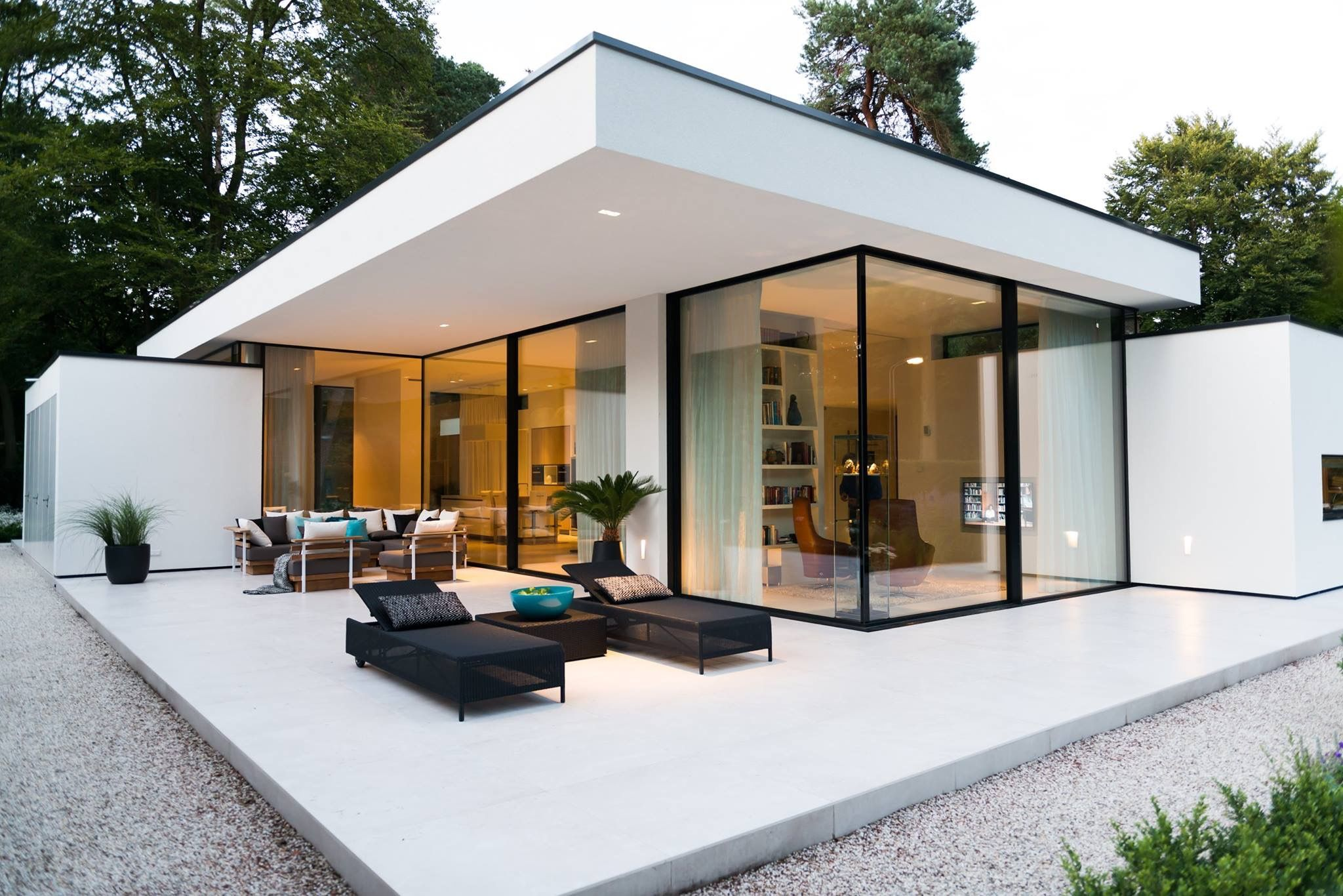 Black and white modern ceiling to floor glass design outdoor lounge on veranda