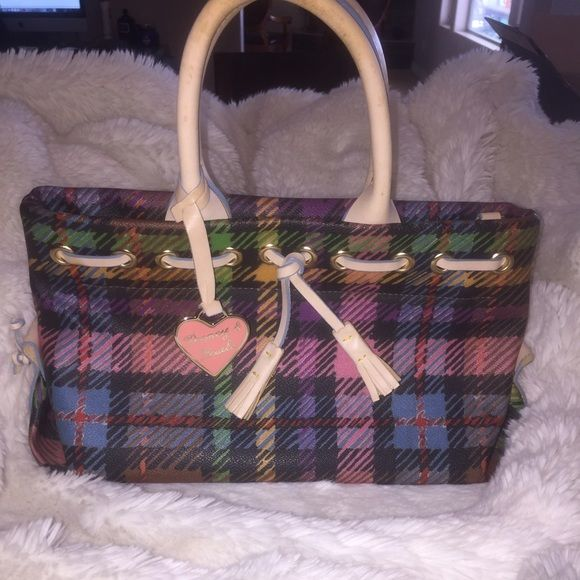 Dooney and Bourke Bag This Dooney and Bourke bag is almost perfect! The outside and inside is in perfect condition it's just the handles that have some discoloration. Dooney & Bourke Bags