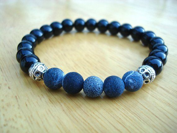 Mens Spiritual Healing, Love Protection Bracelet with Semi Precious Blue Matte Agates 8mm, Black Jasper 8mm, Bali beads. A classy combination of colors for the high fashion man. Very elegant bracelet fits a wrist of 7 1/2 to 8 1/2 inches since it has been beaded with high quality elastic