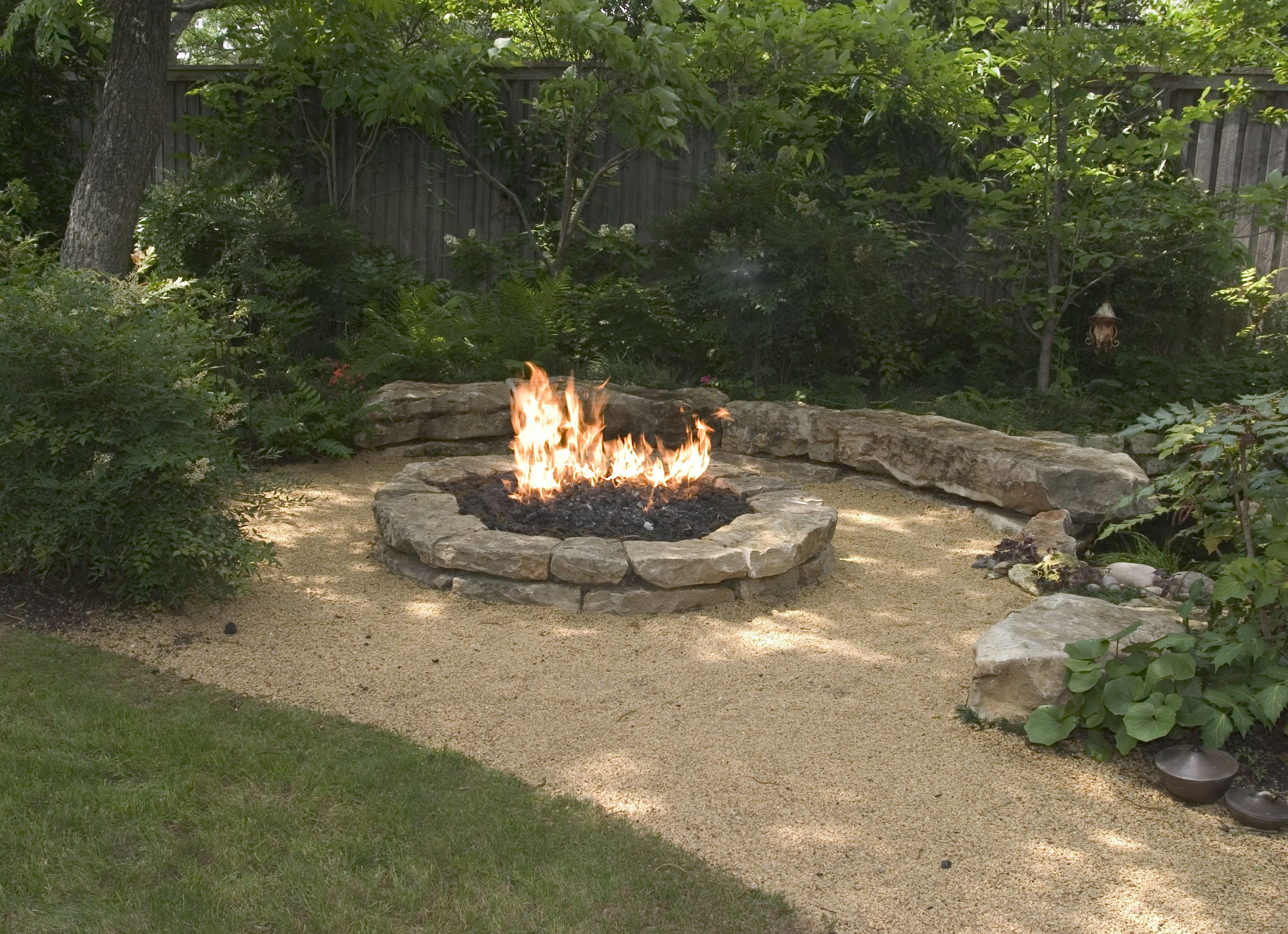 Stone fire pit designs patio traditional with artistic hardscape - Backyard Landscaping Ideas Attractive Fire Pit Designs