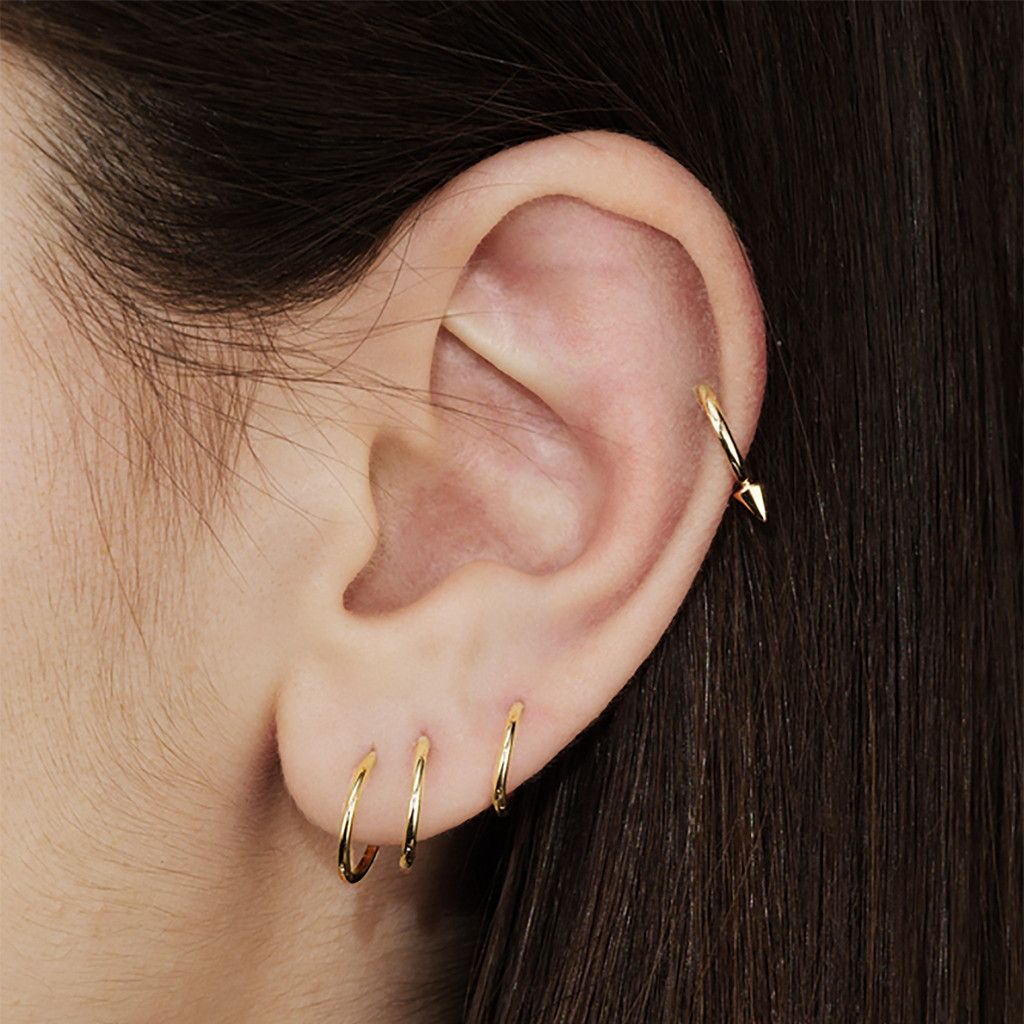 Like a classic clicker ring, but with the added bonus of a single badass spike. This one is sized up for the earlobe. Piercer, body jewelry trailblazer, and overall badass Maria Tash has gotten up clo
