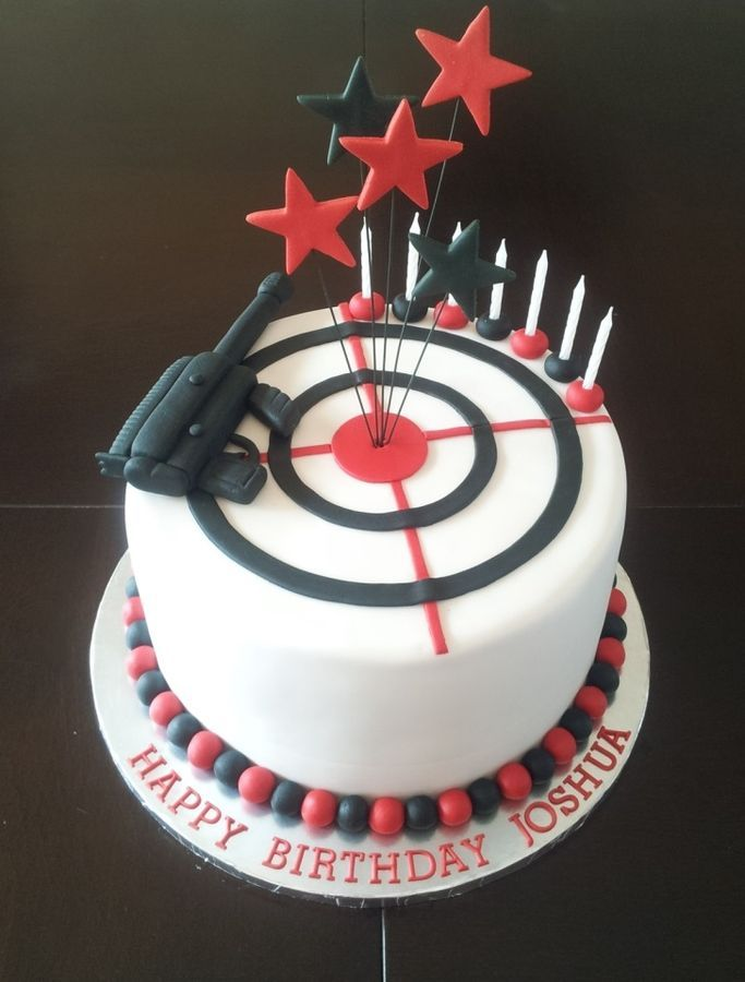 This is a cake for a Laser Tag theme with target and gun Cake