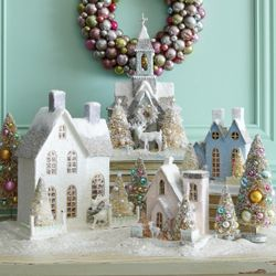 I bought a boatload of these sparkly cardboard houses at TJ Maxx this year. I'm going to group them this way next year. Love it!