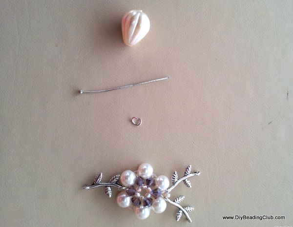 Leaf & pearl necklace Step 15:  Bring up your tear drop bead, T-pin and 1 jump ring.