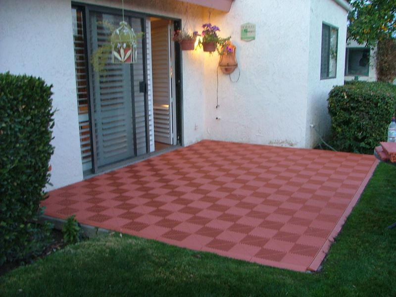 patio with interlocking deck tiles gray on grass Google