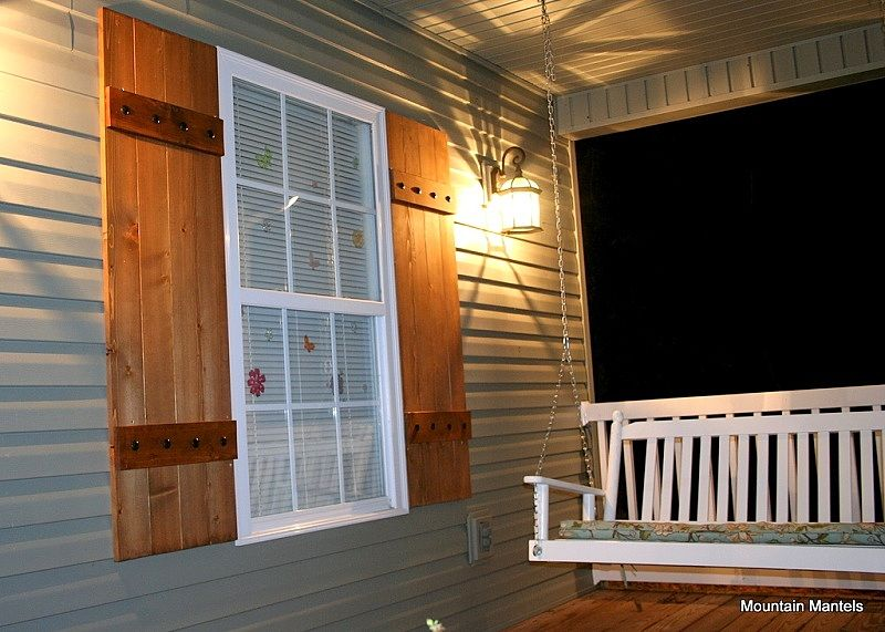 wood board and batten stained shutters with metal bolts. Black Bedroom Furniture Sets. Home Design Ideas