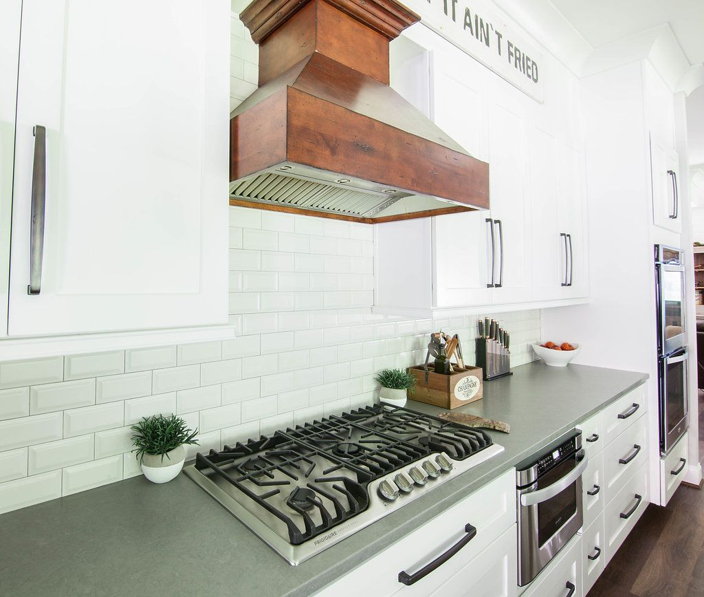 Farmhouse kitchen with white shaker grey quartz
