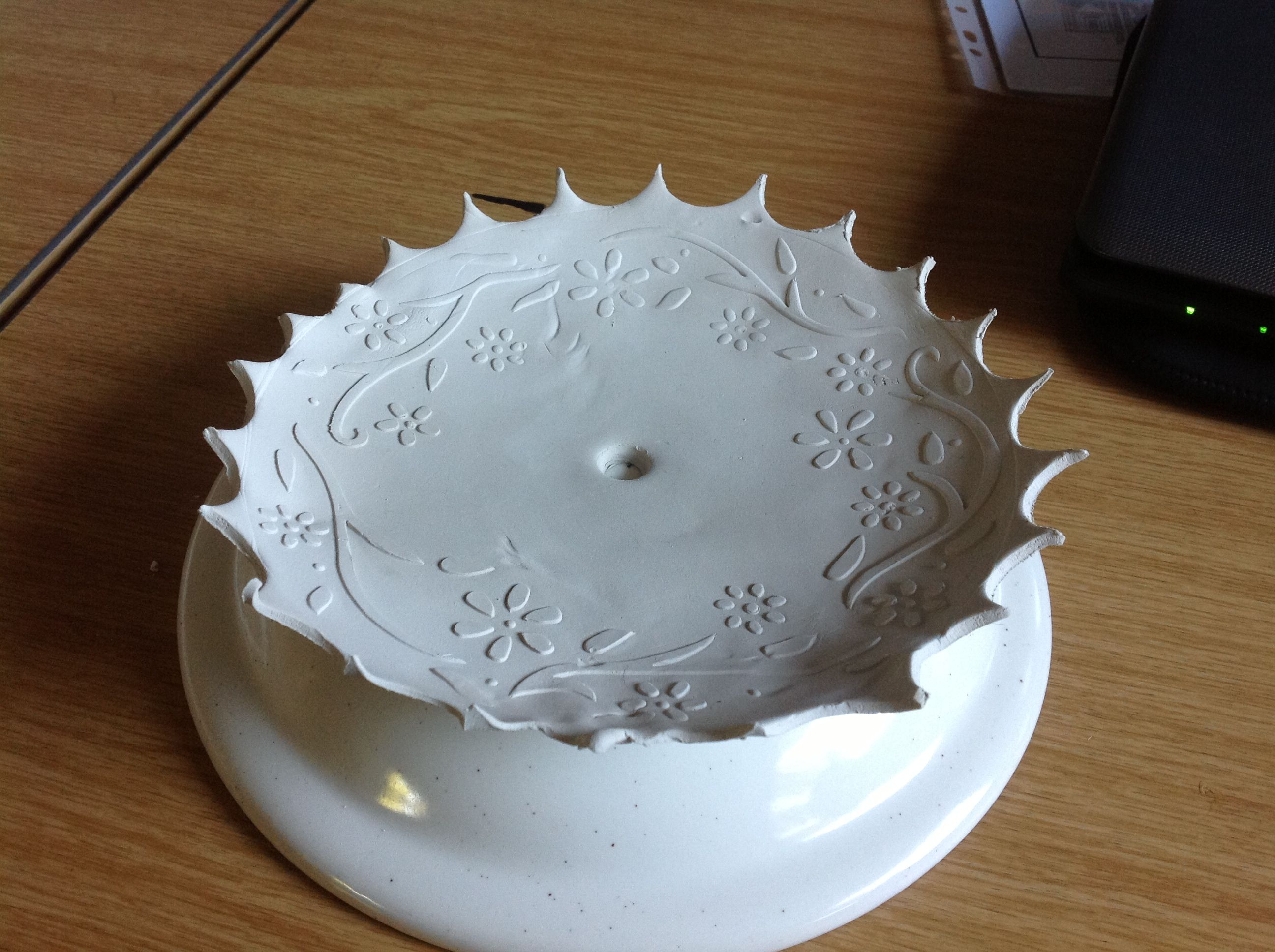 Plate stand. Air dried clay   Used a stencil and dried clay in a suitable sized bowl