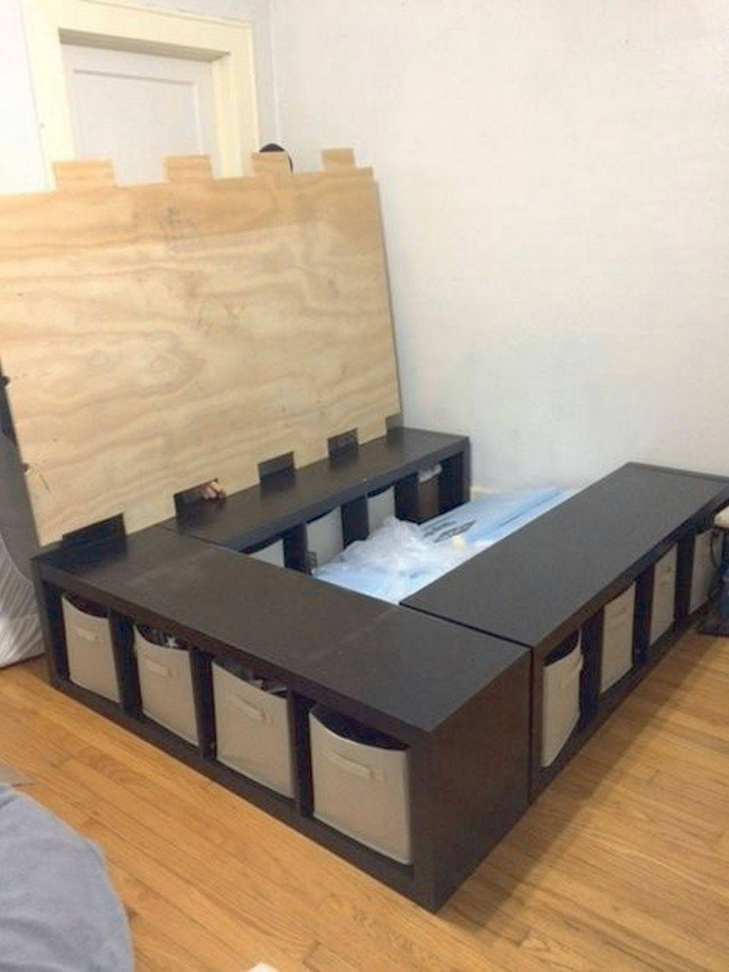 DIY Storage Bed place three 4cube storage shelves in a u