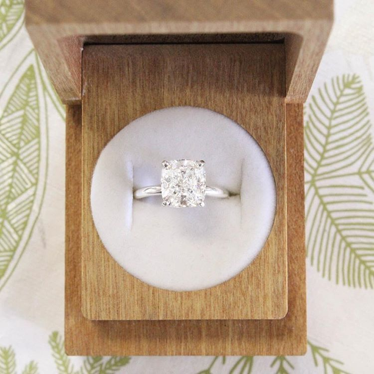 A Certified Cushion White Diamond Engagement Ring In Solid Gold