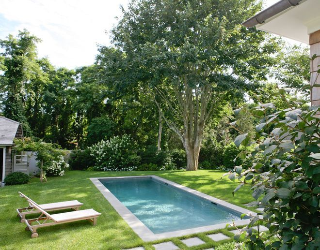 Classic pool. A rectangular inground pool is the backyard