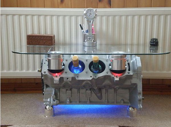 Engine block coffee table with piston bores that act as for Engine parts furniture