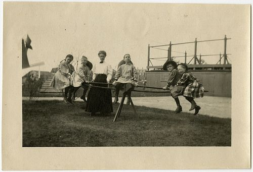 Girls from the Kindergarten of the Perkins Institution for the Blind in Jamaica Plain, Massachusetts, pose on a merry-go-round with their teacher, ca. 1900-1910. Visit the Perkins Archives Flicker page: http://www.flickr.com/photos/perkinsarchive/collections/