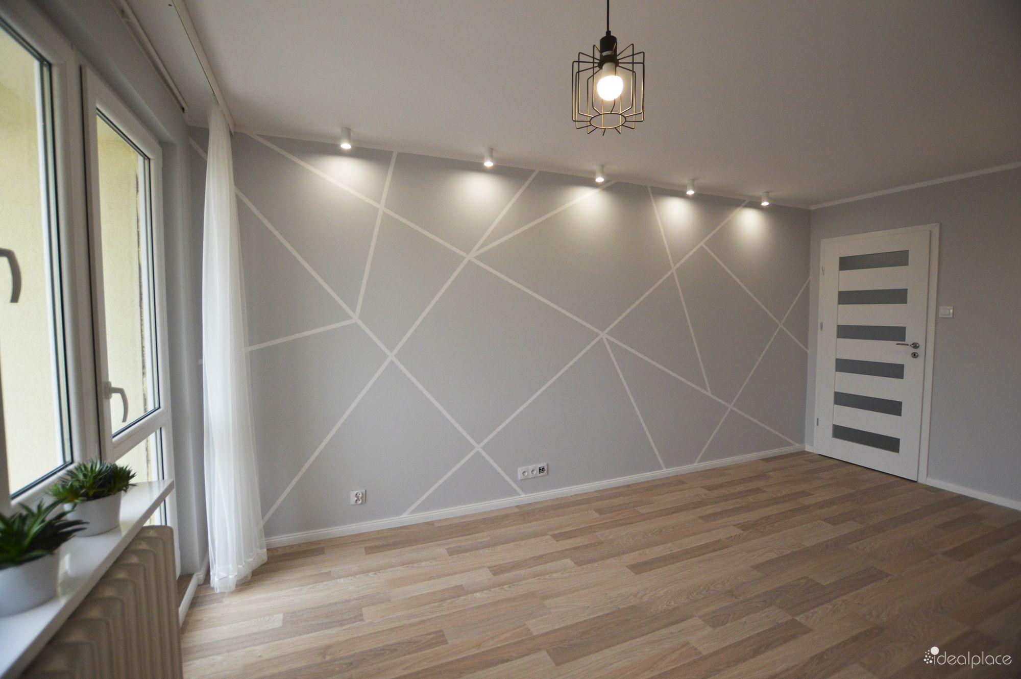 Photo of ściana we wzory geometryczne, wykonane za pomocą taśmy malarskiej i farby