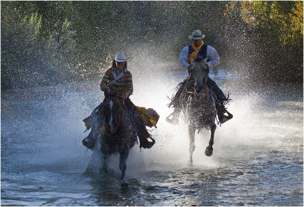Gallop through a Wyoming river on horseback.