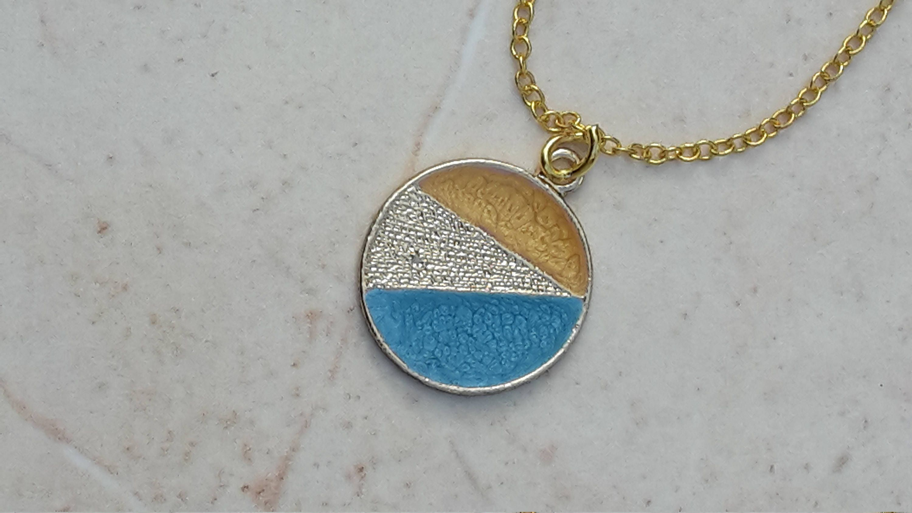 Small Circle Pendant With Bright Blue And Yellow Colour Details