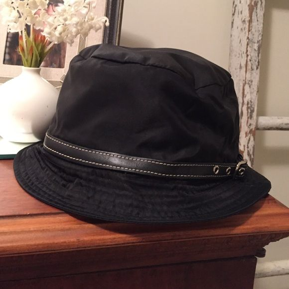Coach nylon hat Great Coach rain hat. Cute leather trim with nuclear. Size  m l. Worn once...I m just not a hat person Coach Accessories Hats fd6e74af7bd