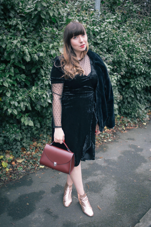 Black Velvet Midi Wrap Dress Gold Ankle Boots Oxblood Cambridge Satchel Poppy Bag Mesh Layered Top Black Zara Faux Fur Jacket Long Brown Hair Full Fringe [ 3000 x 2000 Pixel ]
