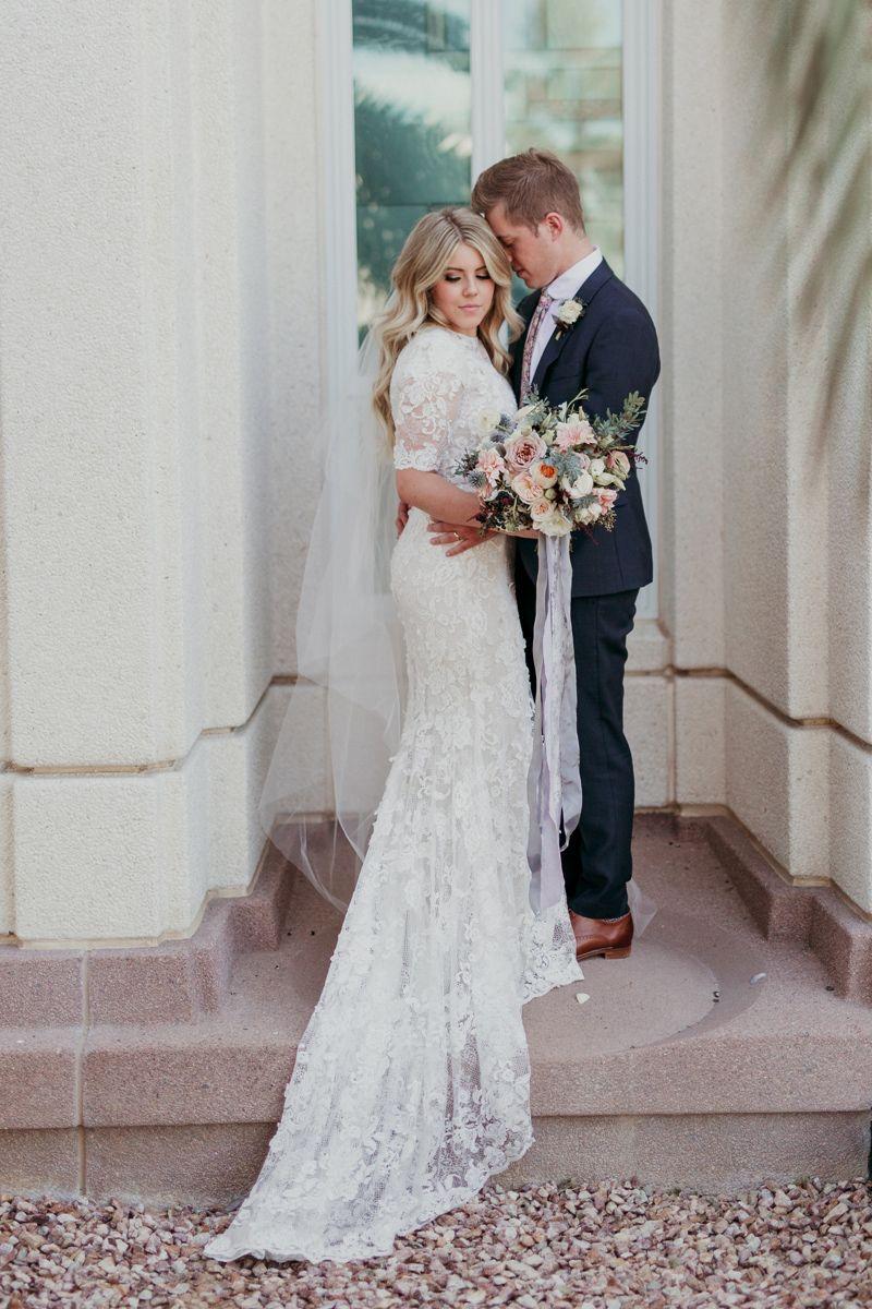 Cream colored vintage wedding dresses  shortsleevemodestlaceweddingdresswithflowytrain  Wedding
