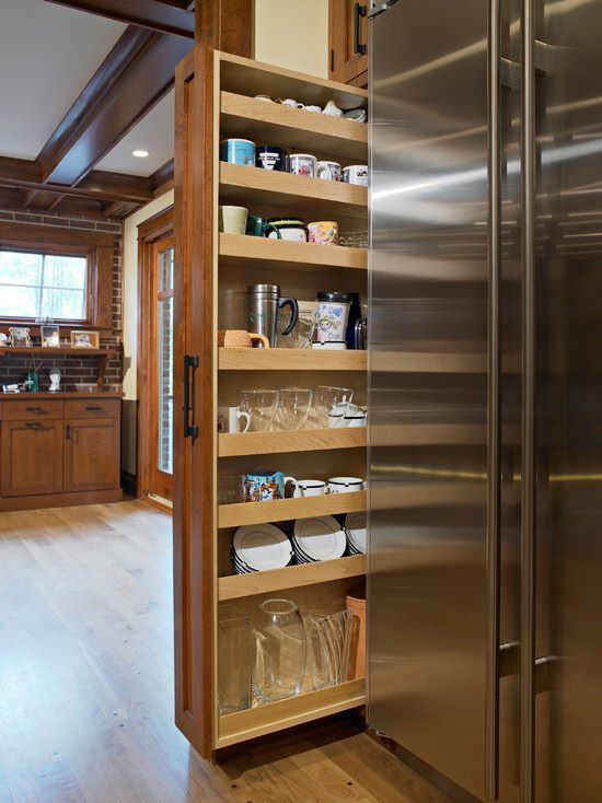 Rollout pantry  It is easier to put the groceries away quickly if you don t  have to fumble around in deep cabinets trying to see what you have and  where. Rollout drawers solution for saving space in your kitchen   Hidden