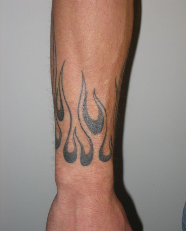 f55ccc4c2 flame tattoo on arm Unique fire and flame tattoo on arm Tribal flame .