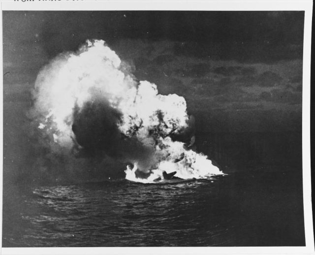 """""""A Japanese Navy G4M (""""Betty"""") bomber sinks in flames, shot down during an attack on Task Force 58 in the night of 22-23 February 1944. TF-58 was then preparing to launch strikes on Japanese facilities in the Mariana Islands."""""""