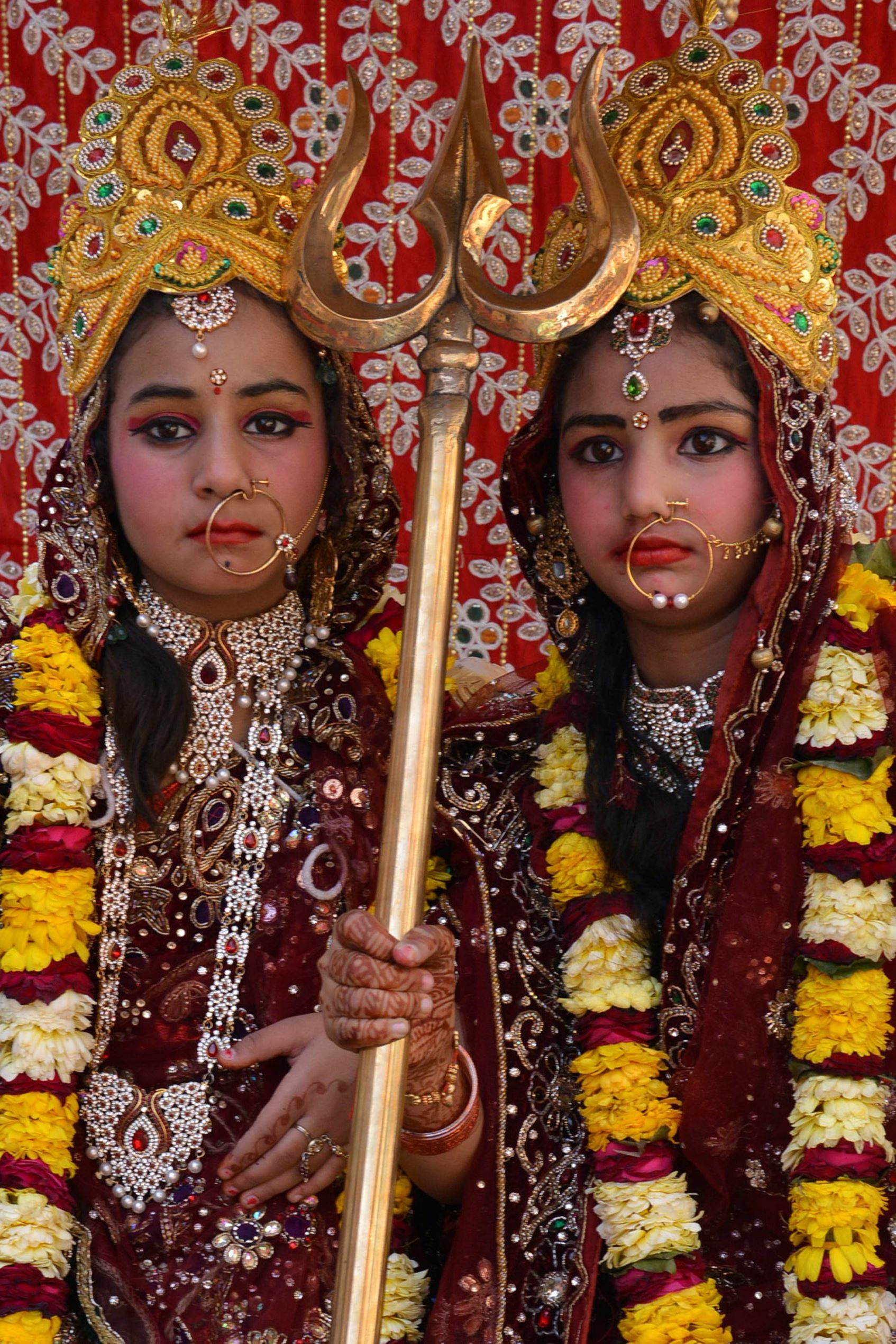 Two Indian girls, both dressed as deity Durga Mata, participate in a Hindu religious procession on the occasion of the Ram Navmi Festival, Amritsar, India. Navmi commemorates the birth of Hindu deity Rama.