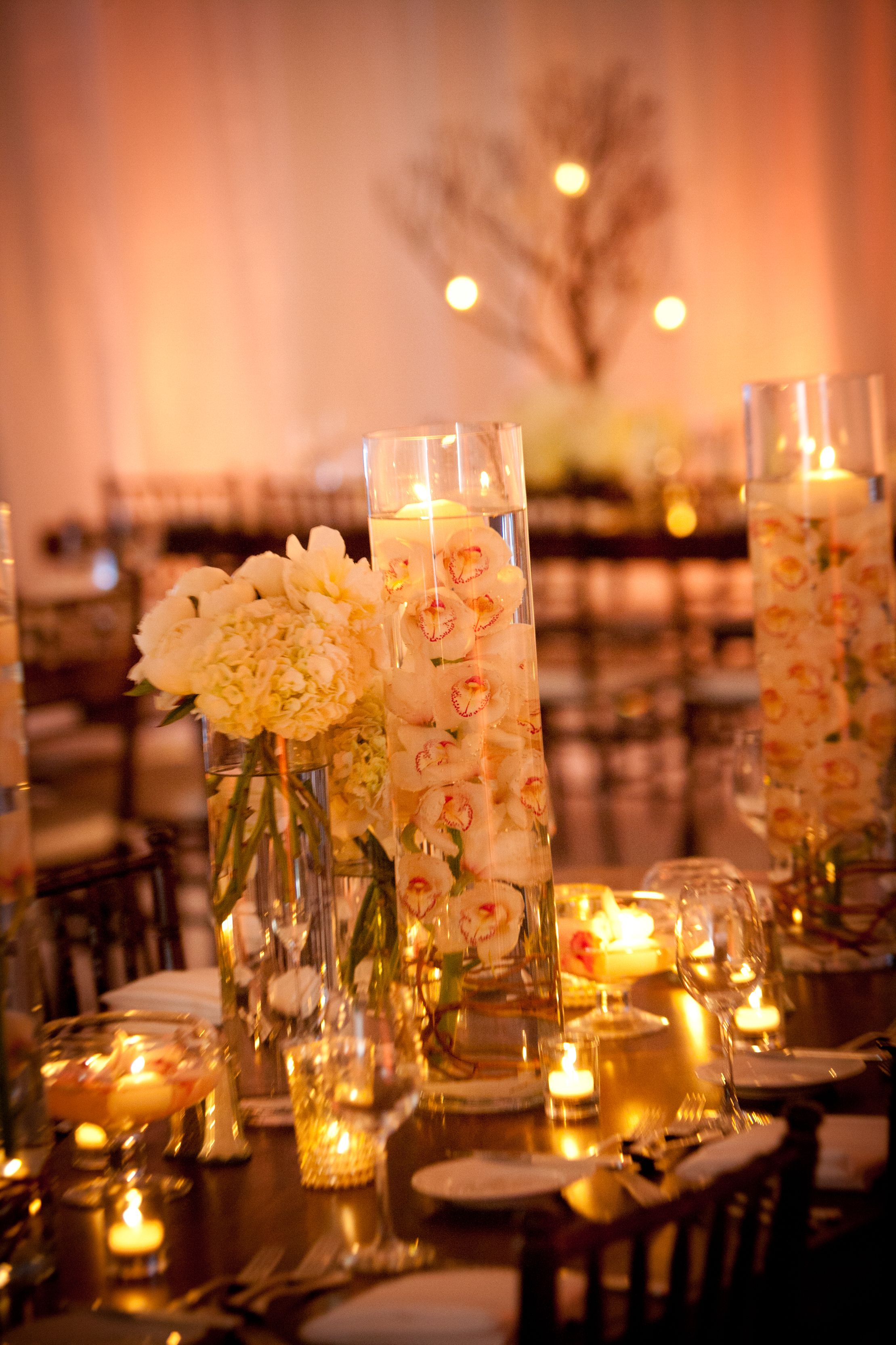 Romantic Orchids With Floating Candles On Amalfi Tables By Lotus