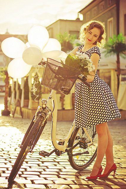 Retro Cycle Chic by Agnieszka Werecha www.TiAmoFoto.etsy.com bicycle bike baloons smile girl woman sunset high heels red lips polka dot dress flowers basket city street photography portrait lifestyle