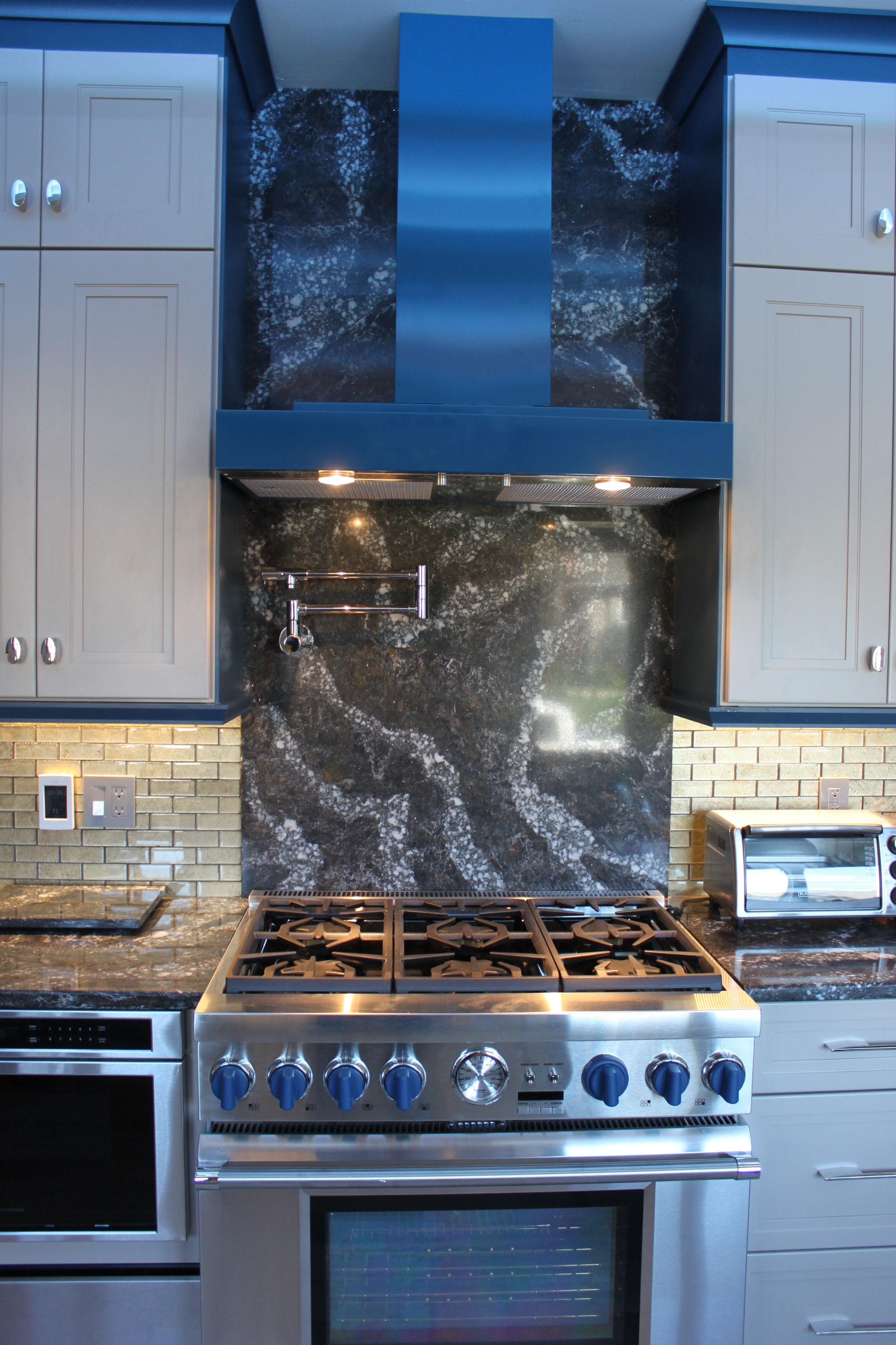 Cambria Ellesmere Quartz countertop and Range Backsplash. Designed ...