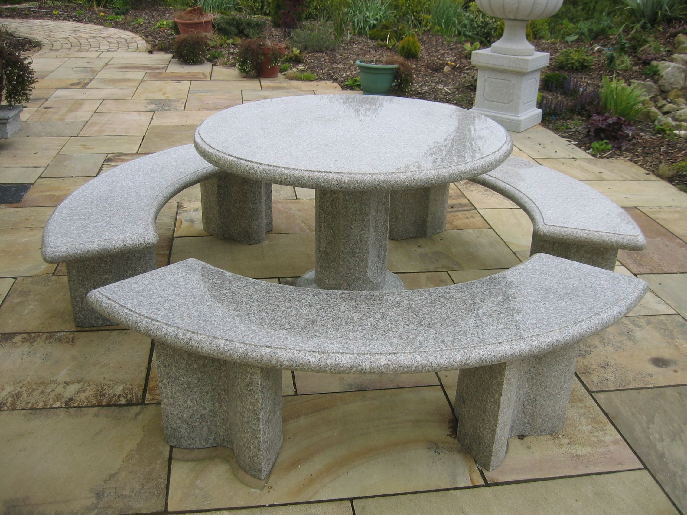 This Beautiful Polished Stone Round Table And Chairs A Perfect Focal Point For Any Patio Or Garden Granite Furniture Garden Table And Chairs Granite Table