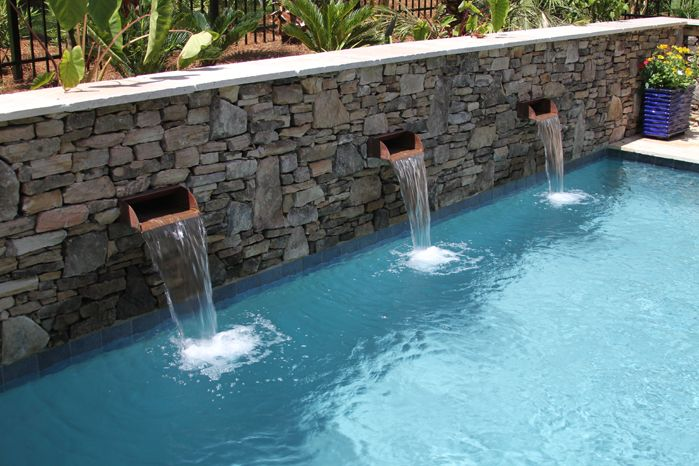 this rectangle swimming pool and spa combination with natural stone walls and copper scupper water features has set the stage for future plans to extend the - Rectangle Pool With Water Feature