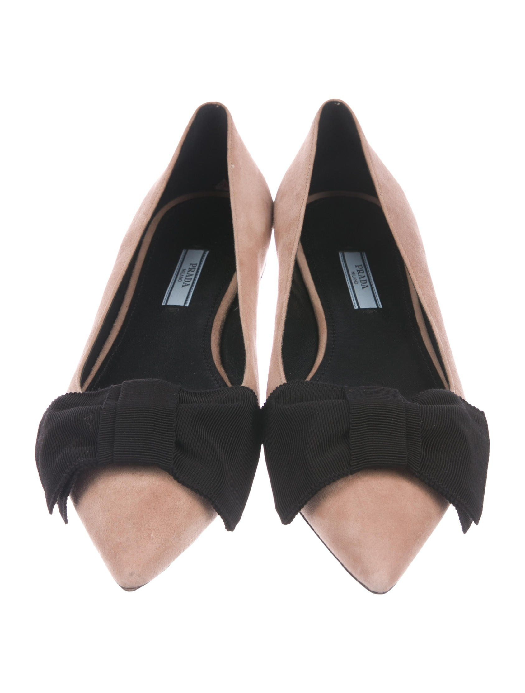 b70145bb2 Mauve suede Prada pointed-toe flats with bow accents at vamps, tonal  stitchings and covered heels.